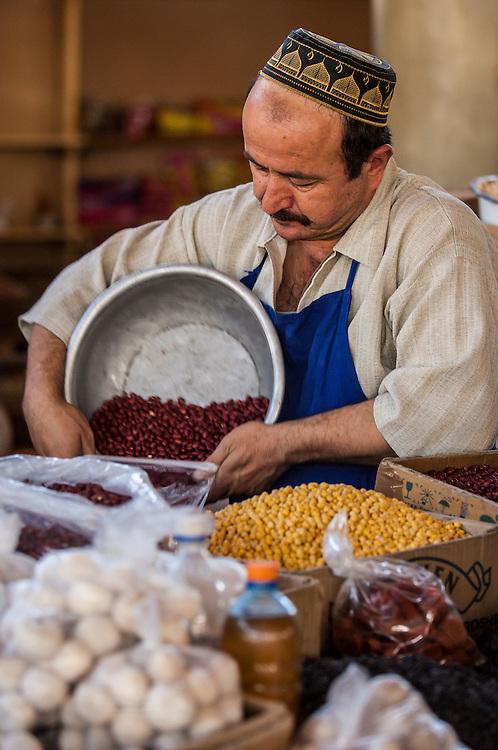 Portrait of a Tajik man selling beans in a market in western Tajikistan