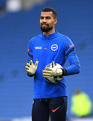 Brighton and Hove Albion goalkeeper Robert Sanchez warming up prior to kick-off during the Premier League match at the American Express Community Stadium, Brighton. Picture date: Saturday May 15, 2021.