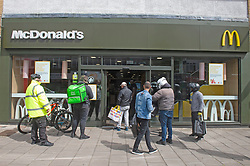 ©Licensed to London News Pictures 13/05/2020<br /> Welling, UK. Queues of food delivery drivers outside McDonalds in Welling High Street, South East London. Some McDonalds restaurants in the UK have opened today from 11am for McDelivery service only after being closed for weeks due to the Coronavirus lockdown. Photo credit: Grant Falvey/LNP