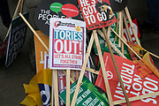 Pile of placards at the Peoples Assembly Against Austerity demonstration against cuts for health, homes, jobs and education onSaturday April 16th in London, United Kingdom. Tens of thousands of people gathered to protest in a march through the capital protesting against the Conservative Party cuts. Almost 150Councillors fromacross the countryhave signed a letter criticising the Government for funding cuts and and will be joining those marching in London. The letter followed the recent budget in which the Government laid out plans to cut support for disabled people while offering tax breaks for big business and the wealthy.