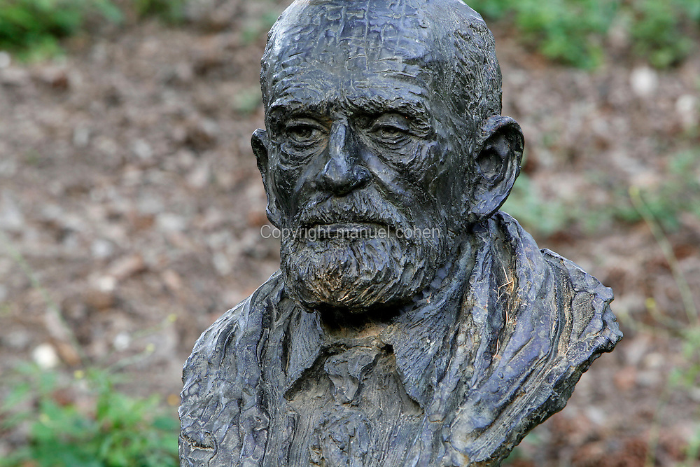 Bust statue of Theodore Monod seen at sunrise, created by Nacera Kainou in 2001 and located at the bottom of the Labyrinth in the Jardin des Plantes, Paris, 5th arrondissement, France. Nacera Kainou is French contemporary sculptor and painter who was chosen by the Museum National d'Histoire Naturelle to create the statue as a memorial to Theodore Monod at his death in 2000. Founded in 1626 by Guy de La Brosse, Louis XIII's physician, the Jardin des Plantes, originally known as the Jardin du Roi, opened to the public in 1640. It became the Museum National d'Histoire Naturelle in 1793 during the French Revolution. Picture by Manuel Cohen