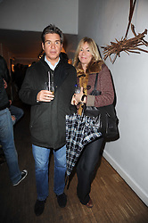 HUGO DE FERRANTI and ALEX JENNINGS at a private view of Henry Brudenell-Bruce's work held at 269 Portobello Road, London, W14 on 24th November 2009.
