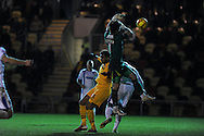 Wimbledon goalkeeper Ross Worner drops the ball as Newport's Rene Howe scores his sides 1st goal. Skybet football league 2 match, Newport county v AFC Wimbledon  at Rodney Parade in Newport, South Wales on Tuesday 25th Feb 2014.<br /> pic by Andrew Orchard, Andrew Orchard sports photography.