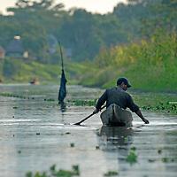 A Yanayacu Indian fisherman floats in his canoe in the Yanayacu River in Peru's Amazon Jungle.
