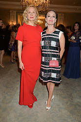 Left to right, DINA KORZUN and CHULPAN KHAMATOVA at the Gift of Life Gala Ball celebrating the Russian Old new Year's Eve in aid of the Gift of Life foundation held at The Savoy, London on 13th January 2015.