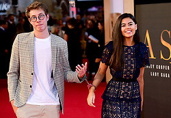Callum Leighton and Emily Canham are handcuffed together whilst attending the UK Premiere of A Star is Born held at the Vue West End, Leicester Square, London.