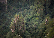 Aerial view shot of a majestic landscape with mountains with steep cliffs and forest below, Zhangjiajie National Forest Park, Hunan Province, China