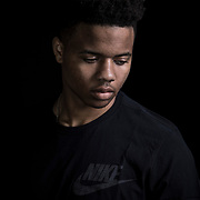 """Markelle Fultz at the North Laurel Community Center ahead of the NBA Draft, in Laurel, MD, on Monday, June 12, 2017. Fultz, 19, a 6'6"""" point guard, played one year at the University of Washington and was expected to be the first pick in the NBA draft by the Boston Celtics. He has a quote from Dr. Martin Luther King tattooed on his body that says, """"The ultimate measure of a Man is not where he stands in the moment of comfort and convenience, but where he stands at times of challenge and controversy."""" The Celtics traded their pick to the Philadelphia 76ers, who drafted Fultz. Fultz has spent most of his rookie year sidelined by a shoulder injury. For The Boston Globe"""