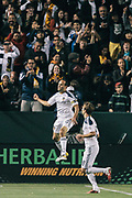 Los Angeles Galaxy forward Landon Donovan celebrates scoring on a penalty kick with teammate Mike Magee during the first half of an MLS soccer match against the Portland Timbers, Saturday, April 23, 2011, in Carson, Calif. (AP Photo/Bret Hartman)