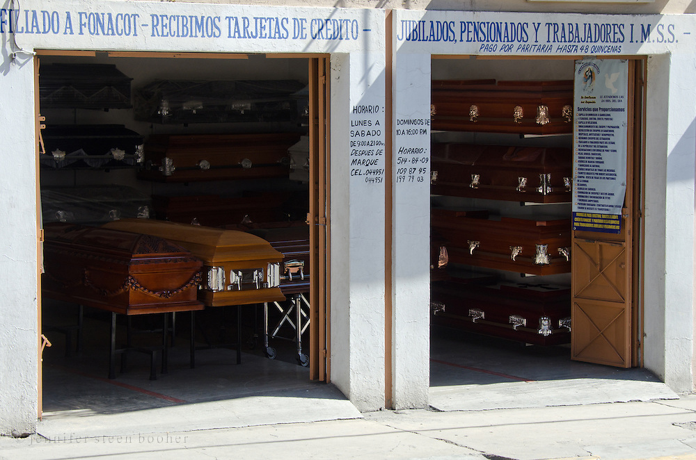 A funeral home in Oaxaca, Mexico opens its storefront to the street.