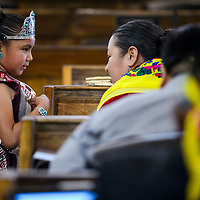 Mariano Lake Community School princess Nayeli Rico greets council delegate Amber Crotty and other delegates on the floor of the Navajo Nation Council in Window Rock Monday.
