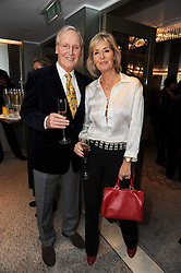 NICHOLAS PARSONS and his daughter SUZY BUCHANAN at the Lady Taverners Tribute Lunch in honour of Nicholas Parsons held at The Dorchester, Park Lane, London on 20th November 2009.