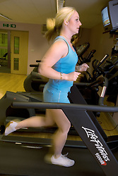 Woman running on the treadmill at Southglade Leisure Centre; Nottingham
