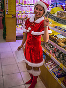 24 DECEMBER 2012 - BANGKOK, THAILAND:  A waitress in a Christmas outfit at Bei Otto, a German bakery/restaurant on Sukhumvit Soi 20 in Bangkok. Thailand, a predominantly Buddhist country, has a spirited Christmas season, influenced by the large number of ex-patriots that live in Thailand and tourists who visit Thailand.        PHOTO BY JACK KURTZ