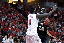 """20 March 2017:  Daouda """"David"""" Ndiaye (4) can't stop Tacko Fall during a College NIT (National Invitational Tournament) 2nd round mens basketball game between the UCF (University of Central Florida) Knights and Illinois State Redbirds in  Redbird Arena, Normal IL"""