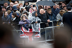 © London News Pictures.17/04/2013. London, UK.  Members of the public line the streets outside St Paul's Cathedral in London in the rain for The Funeral of former British Prime Minister, Margaret Thatcher on April 17, 2013. Photo credit : Ben Cawthra/LNP
