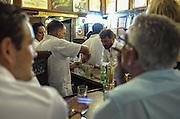 A bartender prepares Mojitos at the popular Habana restaurant La Bodeguita Del Medio.