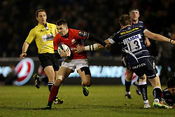 Saracens Richard Wigglesworth holds off Sale Sharks Sam James during the European Champions Cup, pool three mach at the AJ Bell Stadium, Salford.