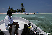 Friends of Nature ranger Jerome Garcia counts visitors to one of the Silk Cayes in the protected Gladden Spit & Silk Cayes Marine Reserve, off Placencia, Belize, Central America ( Caribbean Sea )