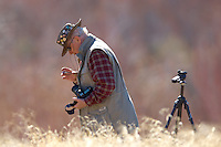 """Photographer checking his filter for dust. Elderhostel """"Southwest Photography"""" Workshop Day 2. Kelly Place Cortez Colorado. Image taken with a Nikon D2xs and 400 mm f/2.8 lens (ISO 100, f/2.8, 1/750 sec)"""