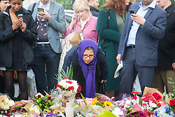 Parliament Square, Westminster, London, June 17th 2016. Following the murder of Jo Cox MP a vigil is held as friends and members of the public lay flowers, light candles and leave notes of condolence and love in Parliament Square, opposite the House of Commons.