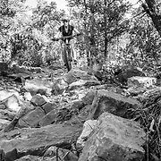 Heather Goodrich riding a rock garden on single track in New Mexico.