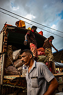 Men load a truck at the Dambulla wholesale produce market in Sri Lanka.