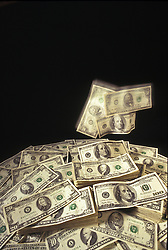 Pile of money in motion. Falling economy. CONCEPT STOCK PHOTOS