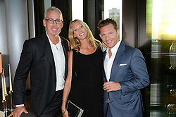 An exclusive preview of the new Samsung OLED Curved TV has hosted by Nick & Holly Candy at their home at One Hyde Park, London on 29th August 2013.<br /> Picture shows:-Eric Watson, Lisa Henrekson and Nick Candy