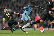Kelechi Iheanacho (Manchester City) is brought down by Scott Brown (Celtic) just outside the penalty box and a free kick is awarded during the Champions League match between Manchester City and Celtic at the Etihad Stadium, Manchester, England on 6 December 2016. Photo by Mark P Doherty.