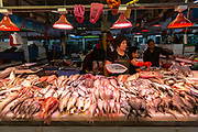 A woman sells fish at a wet market in Huizhou, Guangdong province, China, on Monday, April 18, 2016. Once synonymous with Chinas manufacturing might, as the days of cheap land and labor recede, the provinces businesses are in a race to upgrade or move.
