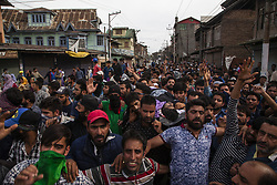 May 5, 2018 - Srinagar, Kashmir, India - Kashmir Muslim carry the body of Adil Ahmad Yadoo, a civilian killed after an Indian police vehicle ran him over, during his funeral on May 5, 2018 in  Srinagar, the summer capital of Indian administered Kashmir, India. Three rebels were killed  during a gun battle with Indian forces in Srinagar, while a boy was run over by a vehicle of Indian armed forces in the old city of the summer capital the disputed Himalayan region on Saturday. Two rebels have been identified as local commanders and the identity of the third  slain militants was being ascertained, police said. The civilian who was run over has been identified as Adil Ahmed Yadoo. Police initially dismissed the incident as a road accident but was forced to order a probe after a video of a police vehicle mowing down the youth went viral on social media sites ..(Photo by Kabli Yawar/Nur Photo) (Credit Image: © Kabli Yawar/NurPhoto via ZUMA Press)