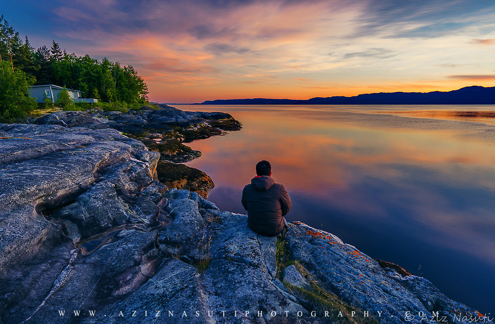 As you can see this picture hasa been taken in a very calm evening time at 11pm. The Trondheimsfjord (Norwegian: Trondheimsfjorden, an inlet of the Norwegian Sea, is Norway's third longest fjord at 130 kilometres (81 mi) long.please note that It is a compositite of two photos both has been taken from Trondheimfjorden but in two different time.  Any comment and feedback will be cosidered and highly appreciated. Please feel free to check my photos here or find me by: |Website| ,|Facebook page| , |Instagram| ,|Google+| ,|Twitter |.