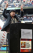 ATLANTA, GA:  Singer and guitarist Carlos Santana gives a speech during the pre-game ceremony before the MLB Civil Rights Game between the Philadelphia Phillies and the Atlanta Braves on Sunday, May 15, 2011 at Turner Field in Atlanta, Georgia.  (Photo by Mike Zarrilli/MLB Photos via Getty Images)