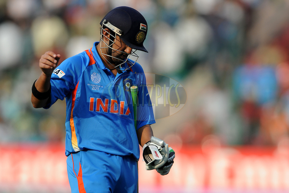 Gautam Gambhir of India walks back after getting out during the ICC Cricket World Cup match between India and England held at the M Chinnaswamy Stadium in Bengaluru, Bangalore, Karnataka, India on the 27th February 2011..Photo by Pal Pillai/BCCI/SPORTZPICS