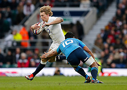 England replacement Billy Twelvetrees is tackled by Italy Prop Alberto De Marchi - Photo mandatory by-line: Rogan Thomson/JMP - 07966 386802 - 14/02/2015 - SPORT - RUGBY UNION - London, England - Twickenham Stadium - England v Italy - 2015 RBS Six Nations Championship.