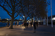 Riverside walkway at night on the Southbank, London, United Kingdom. The South Bank is a significant arts and entertainment district, and home to an endless list of activities for Londoners, visitors and tourists alike.
