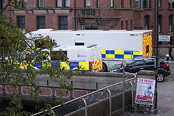 "© Licensed to London News Pictures . 06/10/2013 . Manchester , UK . A specialist police facility is set up . Police pull a body from The Bridgewater Canal in Manchester , adjacent to the City's "" Gay Village "" . The body was spotted yesterday (6th October) afternoon and a cordon was erected as specialist police divers made the recovery . Photo credit : Joel Goodman/LNP"