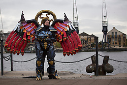 © licensed to London News Pictures. London, UK 28/10/2012. Nikki Tomson cosplaying as Bahamut from Final Fantasy 10 outside ExCeL, London as people visit MCM Expo. Photo credit: Tolga Akmen/LNP