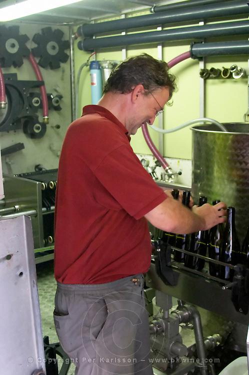 Daniel Le Conte des Floris Domaine Le Conte des Floris, Caux. Pezenas region. Languedoc. Mobile bottling line. Bottling line operator. Owner winemaker. France. Europe.