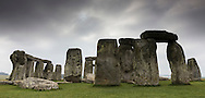 A view of the solar eclipse at the ancient site of Stonehenge in Wiltshire today during a rare triple combination of a partial solar eclipse on the spring equinox plus a 'super' or perigee moon. The spring equinox occurs when the day and night are of equal length and a perigee moon is when the moon is closest to the earth in its orbit. Today, the moon is the closest for 18 years.<br /> Picture date Friday 20th March, 2015.<br /> Picture by Christopher Ison. Contact +447544 044177 chris@christopherison.com