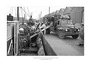 1 Deireadh Fómhair 1958<br /> Trálaer as an bhFrainc á luchtú sa Rinn, Baile Átha Cliath.<br /> <br /> Loading a French Trawler at Ringsend, Dublin. Trawler taking on supplies