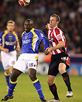 Photo: Paul Greenwood.<br />Sheffield United v Cardiff City. Coca Cola Championship. 02/10/2007.<br />Cardiff's Jimmy Floyd Hasselbaink, (L) battles with Michael Tonge