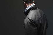 BIRMINGHAM, AL – DECEMBER 19, 2014: An African American male modeling fashionable men's outerwear.