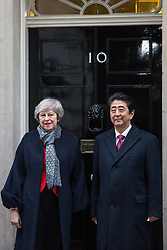 London, UK. 10th January, 2019. Prime Minister Theresa May and Japanese Prime Minister Shinzo Abe stand outside 10 Downing Street before talks. Subjects to be discussed will include the UK's latest arrangements for withdrawal from the European Union.