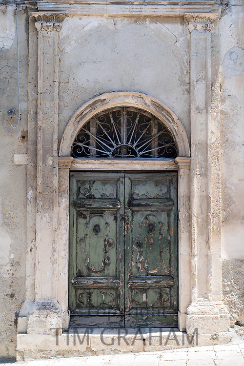 Ancient doorway in Modica Alta famous for its Baroque architecture, South East Sicily, Italy