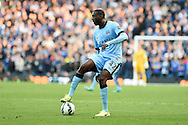 Yaya Toure of Man city in action.Barclays premier league match, Manchester city v Chelsea at the Etihad stadium in Manchester,Lancs on Sunday 21st Sept 2014<br /> pic by Andrew Orchard, Andrew Orchard sports photography.