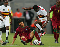 Fotball<br /> VM 2006<br /> Foto: Witters/Digitalsport<br /> NORWAY ONLY<br /> <br /> World Cup 2006 - Group D<br /> Angola v Portugal<br /> 11th June, 2006<br /> v.l. Cristiano Ronaldo, Delgado Angola<br /> Fussball WM 2006 Angola - Portugal
