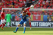 Ben Davies of Wales is challenged by Juraj Kucka of Slovakia. Euro 2016, Wales v Slovakia at Matmut Atlantique , Nouveau Stade de Bordeaux  in Bordeaux, France on Saturday 11th June 2016, pic by  Andrew Orchard
