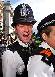 © licensed to London News Pictures. Westminster, UK  30/06/11. Police prevent protesters from leaving Whitehall as thousands of demonstrators took to the streets of London to protest against proposed pension reforms for civil servants. Please see special instructions for usage rates. Photo credit should read LNP